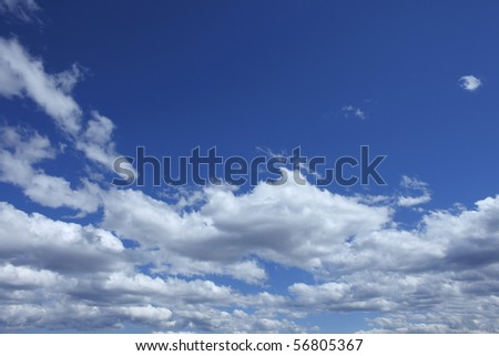 Puffy white Clouds in Blue Sky - stock photo