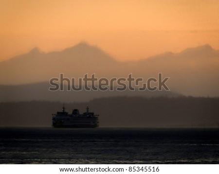 Puget Sound at dusk with Ferry - stock photo