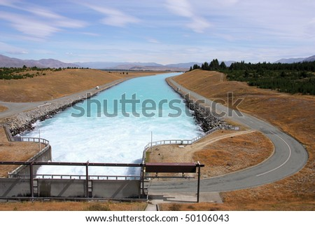 Pukaki canal in New Zealand. Artificial waterway with a dam. - stock photo