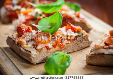 Pull aparat pizza breadwith herbs and basill - stock photo