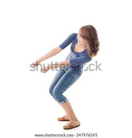 Pull pose, full length portrait of Asian isolated. - stock photo