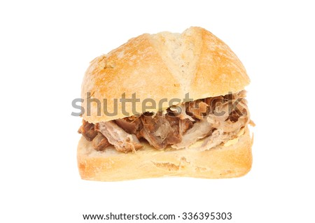 Pulled pork in a sourdough bread roll isolated against white - stock photo