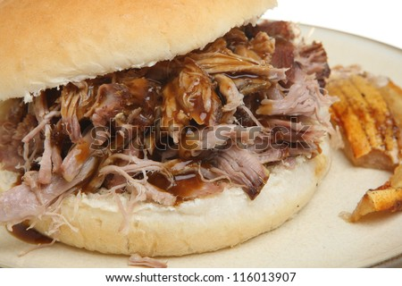 Pulled pork or hog roast sandwich with crackling. - stock photo