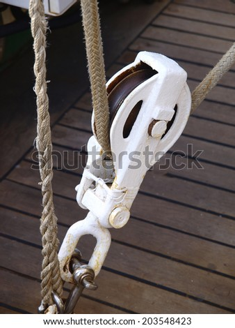 Pulley and rope on a boat. Small detail. - stock photo