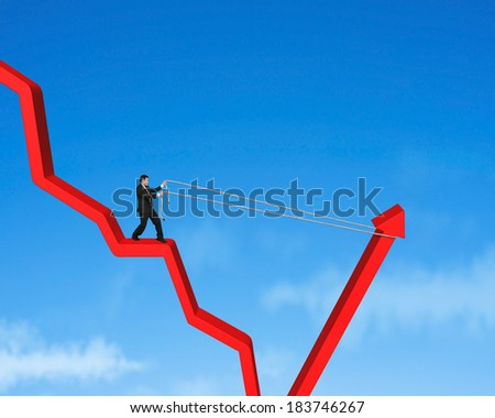 Pulling up going down red arrow blue sky background - stock photo