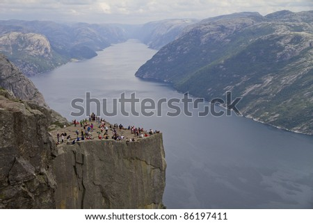 Pulpit Rock at Lysefjorden (Norway). A well known tourist attraction towering 604 meters over sea level - stock photo