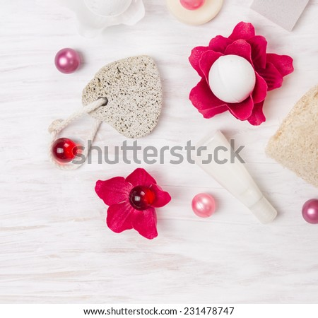 pumice stone and bath set on white wooden table - stock photo