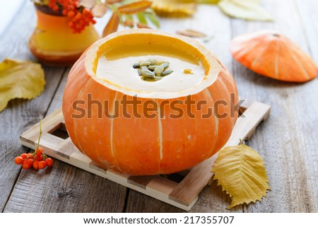 Pumkin cream soup with seeds - stock photo