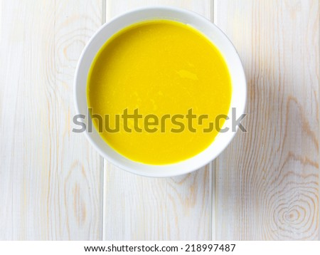pumkin soup, Top view on wood background - stock photo