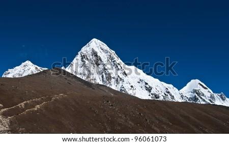 Pumori and Kala Patthar mountains in Himalayas. At height 5100 m - stock photo