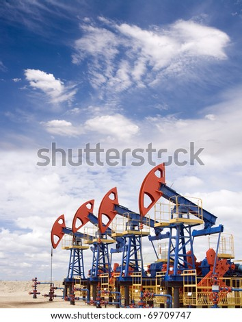 Pump jacks on a oil field - stock photo