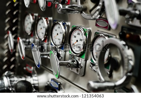 pump panel and discharge gauges and piston valve - stock photo