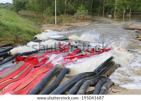 Pumping out water with powerful pumps - stock photo