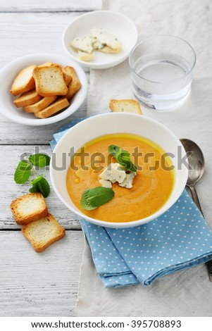 pumpkin and carrot soup with cream, food - stock photo