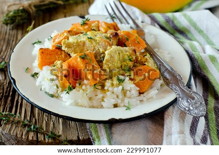 Pumpkin and chicken baked in cream with a side dish of rice - stock photo