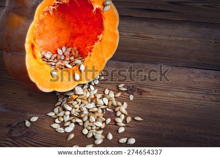 pumpkin and  pumpkin  seeds on wood background food healthy - stock photo