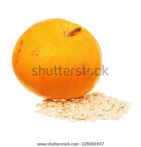 Pumpkin and seeds isolated over white background - stock photo