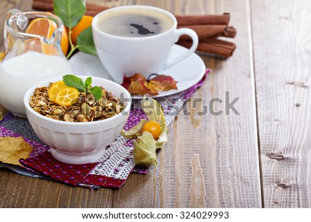 Pumpkin breakfast granola with milk and coffee with copyspace - stock photo