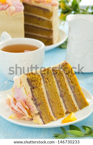 Pumpkin cake with chocolate and caramel cream. - stock photo