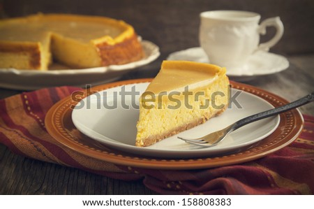 Pumpkin  cheesecake with caramel - stock photo