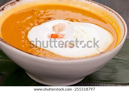 Pumpkin cream soup with shrimps - stock photo