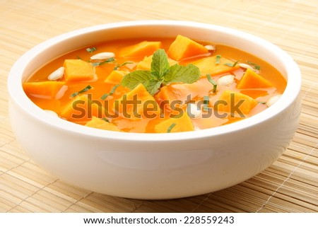 Pumpkin curry with pumpkin slices. - stock photo