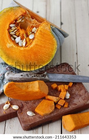 pumpkin cut into slices - stock photo