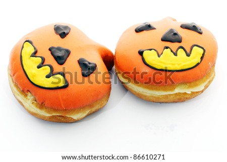 Pumpkin donuts for Halloween. - stock photo