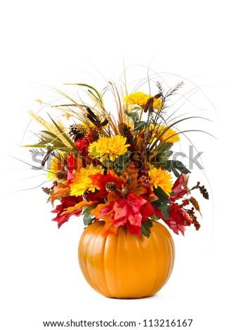 Pumpkin flower arrangement over white - stock photo