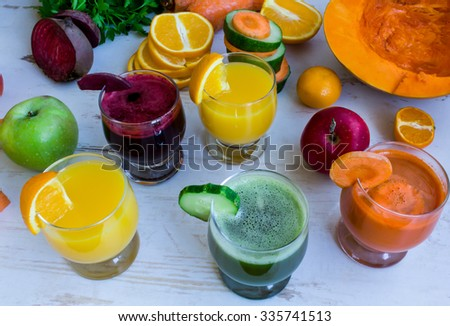 Pumpkin fresh juice, beet juice, cucumber juice. Orange fresh juice. Vegetables and fruit on the table - stock photo