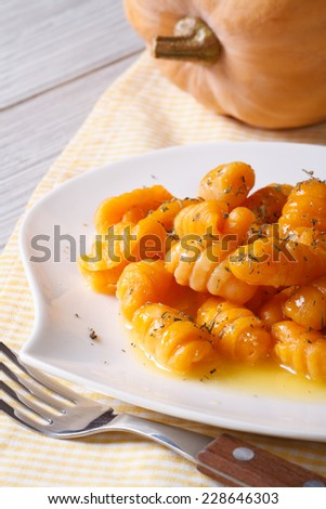 pumpkin gnocchi with sauce and spices on the plate closeup. vertical  - stock photo