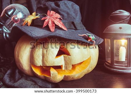 pumpkin Halloween candlestick lamp hat claws selective focus - stock photo