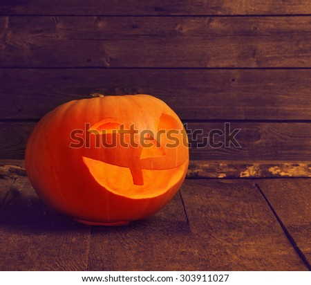 pumpkin head on wooden background with copy space - stock photo