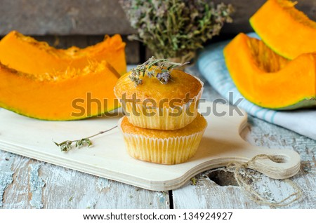Pumpkin muffins with thyme.  Selective focus - stock photo