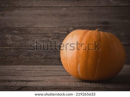 pumpkin o grunge wooden background - stock photo