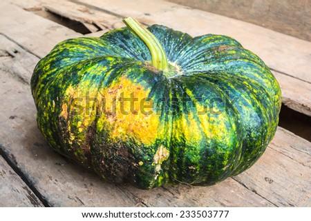 Pumpkin on old wooden - stock photo