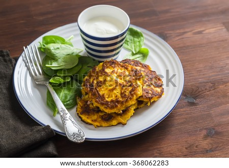 Pumpkin pancakes and fresh spinach. Healthy food - stock photo