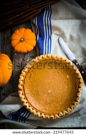 Pumpkin pie on rustic background - stock photo