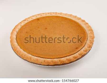 Pumpkin pie with autumn fresh on table - stock photo