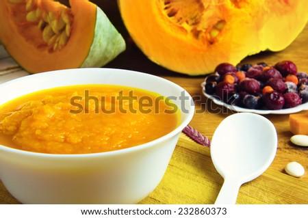 pumpkin porridge and berries - stock photo