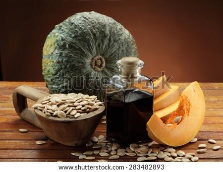 Pumpkin, pumpkin seeds in a scoop and pumpkin seeds  oil bottle - stock photo