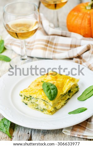 pumpkin ricotta spinach lasagna on a white wood background. the toning. selective focus - stock photo