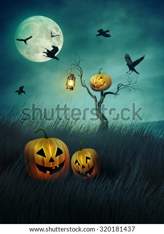 Pumpkin scarecrow in fields of tall grass at night - stock photo
