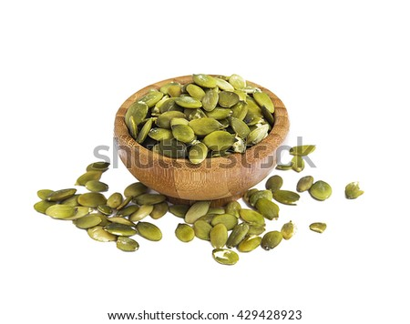 Pumpkin seed in bamboo bowl isolated - stock photo