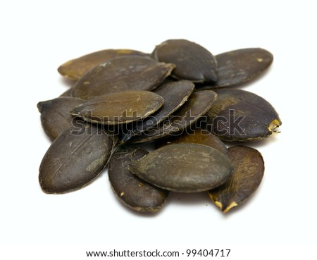 pumpkin seed isolated on white background - stock photo