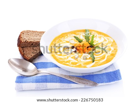 Pumpkin soup and pumpkin slices on napkin, isolated on white - stock photo