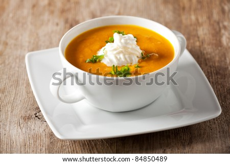 pumpkin soup in a bowl - stock photo