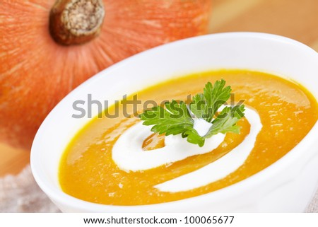 Pumpkin soup in white plate - stock photo