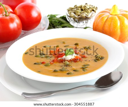 Pumpkin soup that's fit for a fall feast either served warm or cold - stock photo