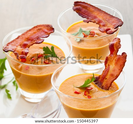 pumpkin soup with bacon in glasses - stock photo